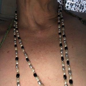 Two vintage rope strands pearl glass beads